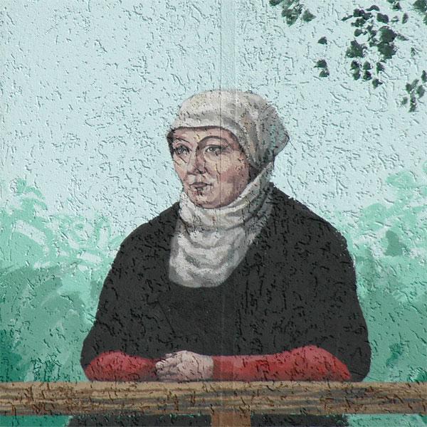 Portrait von Katharina Zell-Schütz auf der Fassade des Künstlerhauses Schillerstrasse in Wittenberg
